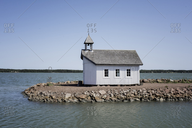 traditional Scandinavian house on the end of pier at sea in summer