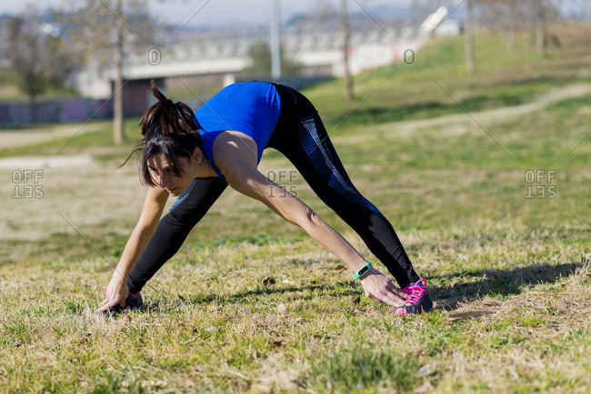 Woman stretching during preparation for a workout
