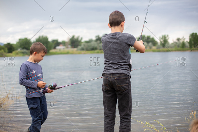 Brothers fishing in a pond