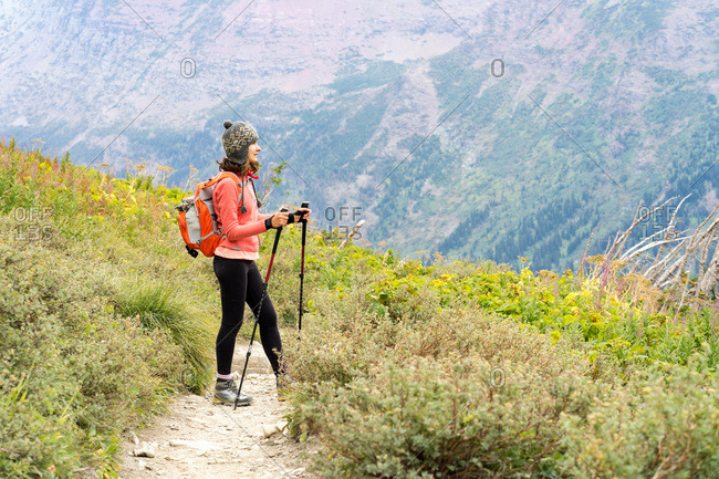 Female hiker is taking a break on the trail in Glacier National Park