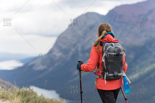 Female hiker is enjoying the view of the lakes in Montana