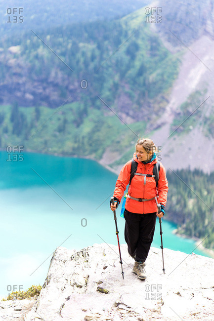 Happy female hiker is ready for the move on the trail in Montana