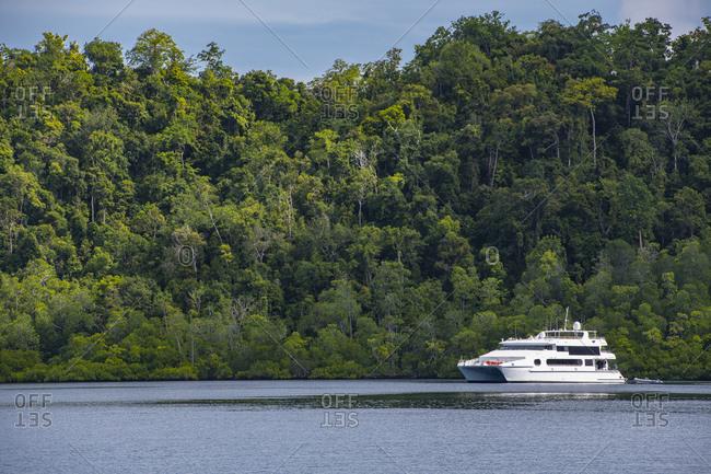 catamaran yacht anchored in Raja Ampat, the last paradise