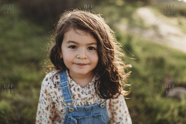 Serious portrait of young brunette girl with brown eyes