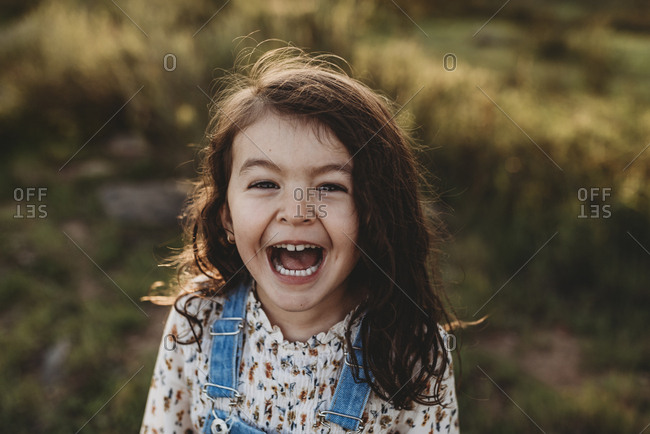 Funny portrait of young school-aged girl with sunlight in her hair