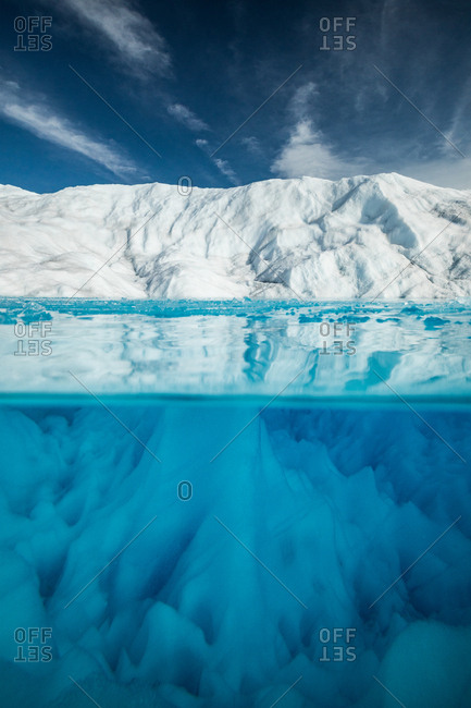 Underwater view of blue pristine lake surrounded by ice