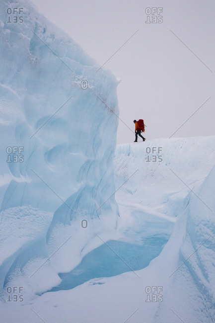 Hiker on adventure exploring the ice cap of Greenland