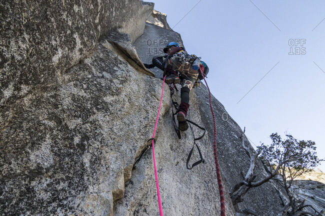 A young woman climber sets out on her first aid climbing lead