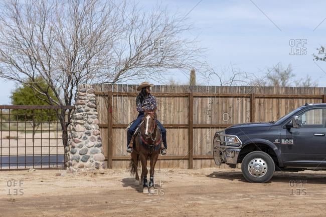 United States, Arizona, Chandler - March 9, 2019: A cowgirl on horseback at the Arizona Black Rodeo