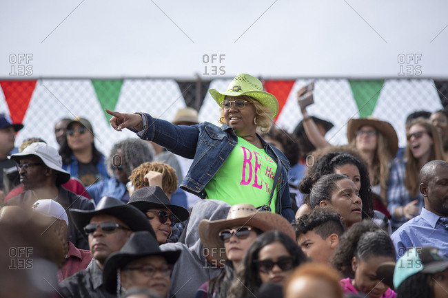 United States, Arizona, Chandler - March 9, 2019: Members of the audience enjoy the Arizona Black Rodeo