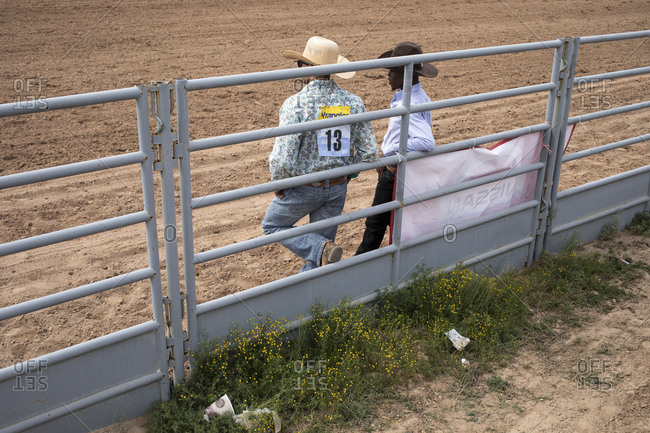 United States, Arizona, Chandler - March 9, 2019: Cowboys talking in the ring at the Arizona Black Rodeo