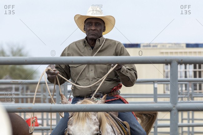 United States, Arizona, Chandler - March 9, 2019: A cowboy gathers his rope backstage at the Arizona Black Rodeo