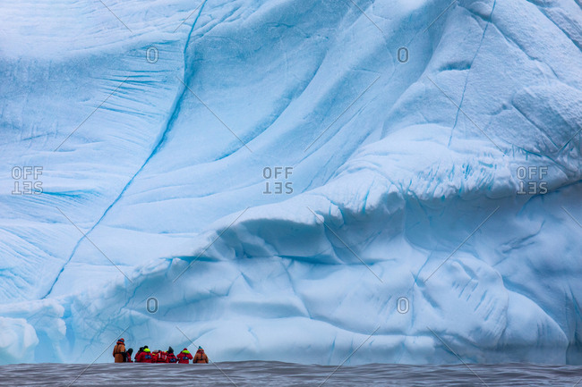 Antarctica, Antarctica, Antarctica Circle - March 15, 2019: People in zodiac boat in front of ice