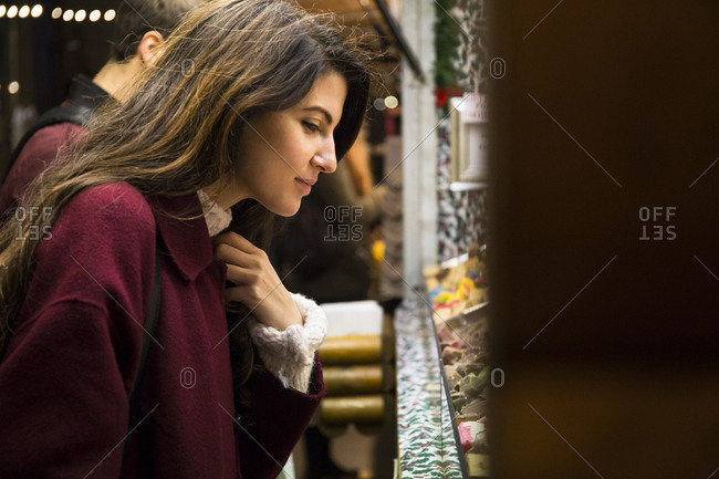 Young woman shopping on Christmas market