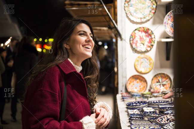 Portrait of laughing young woman on Christmas market