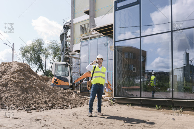 Architect using phone on construction site
