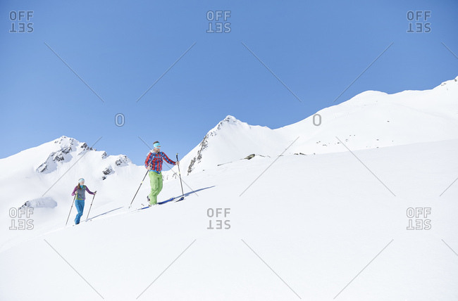 Couple ski touring in the mountains- Kuehtai- Tyrol- Austria