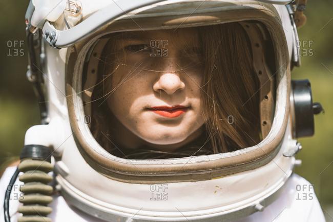 Portrait of girl wearing space helmet