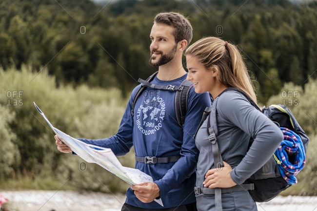 Young couple on a hiking trip reading map- Vorderriss- Bavaria- Germany