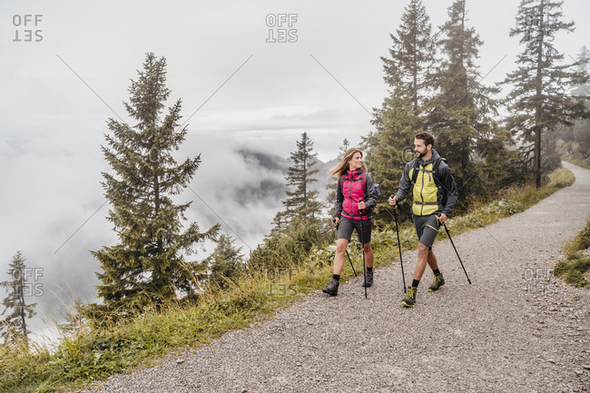 Young couple on a hiking trip in the mountains- Herzogstand- Bavaria- Germany