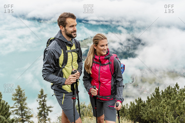Confident young couple on a hiking trip in the mountains- Herzogstand- Bavaria- Germany