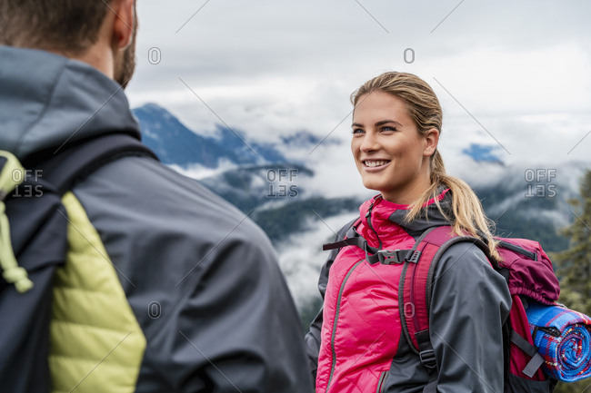 Smiling young couple on a hiking trip in the mountains- Herzogstand- Bavaria- Germany