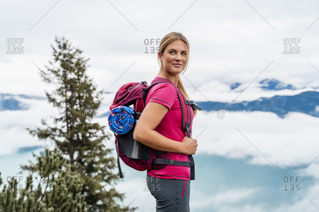 Confident young woman on a hiking trip in the mountains- Herzogstand- Bavaria- Germany