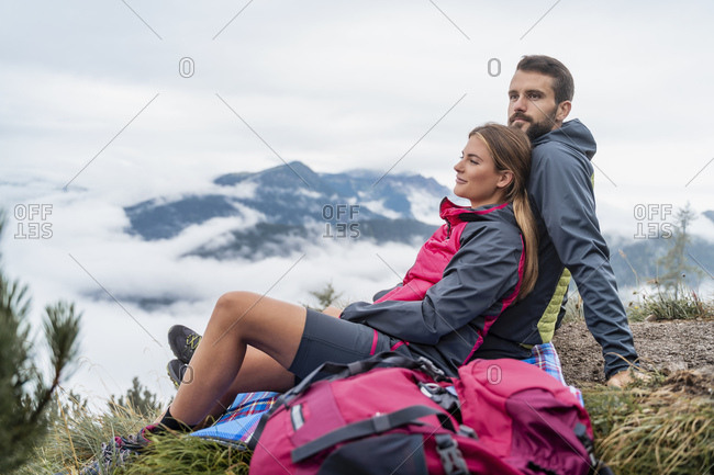 Affectionate young couple on a hiking trip in the mountains having a break- Herzogstand- Bavaria- Germany