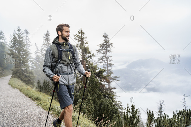 Young man on a hiking trip in the mountains- Herzogstand- Bavaria- Germany
