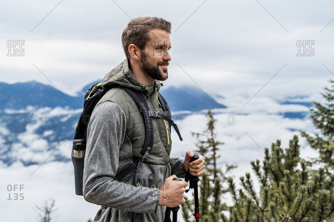 Confident young man on a hiking trip in the mountains- Herzogstand- Bavaria- Germany