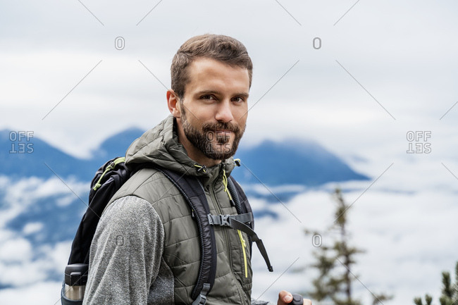 Portrait of confident young man on a hiking trip in the mountains- Herzogstand- Bavaria- Germany