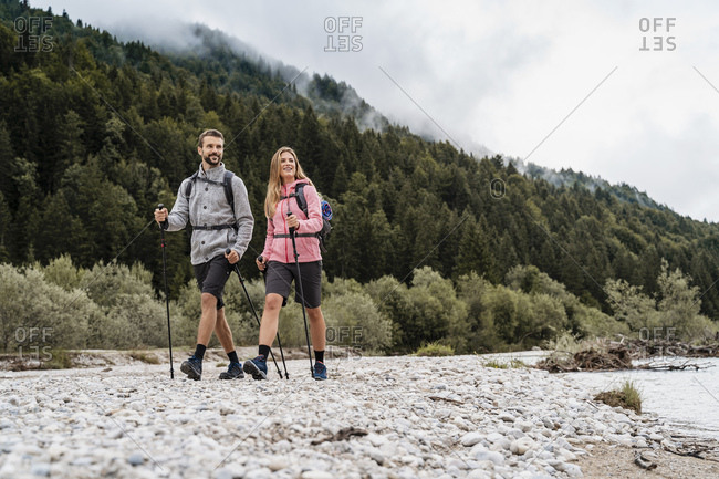 Young couple on a hiking trip at riverside- Vorderriss- Bavaria- Germany