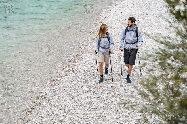 Young couple on a hiking trip walking at the riverside- Vorderriss- Bavaria- Germany
