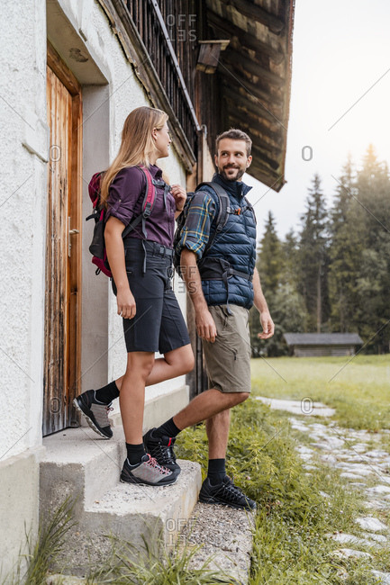 Young couple at a farmhouse during a hiking trip- Vorderriss- Bavaria- Germany