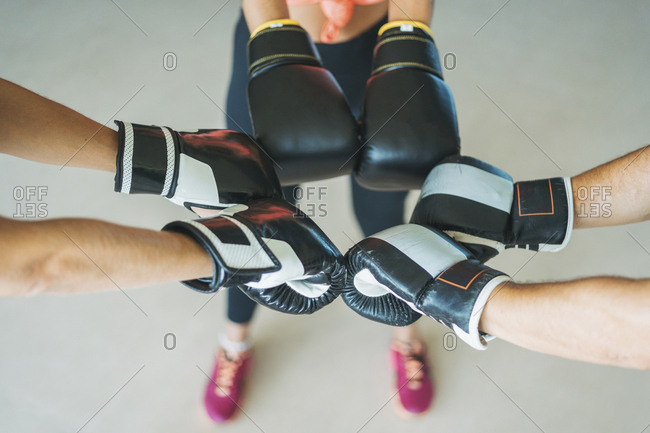 Close-up of training partners with boxing gloves in gym