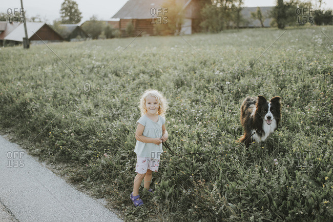 Girl going walkies with dog in the countryside