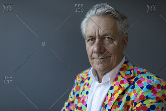 Portrait of a senior businessman wearing colorful sports jacket