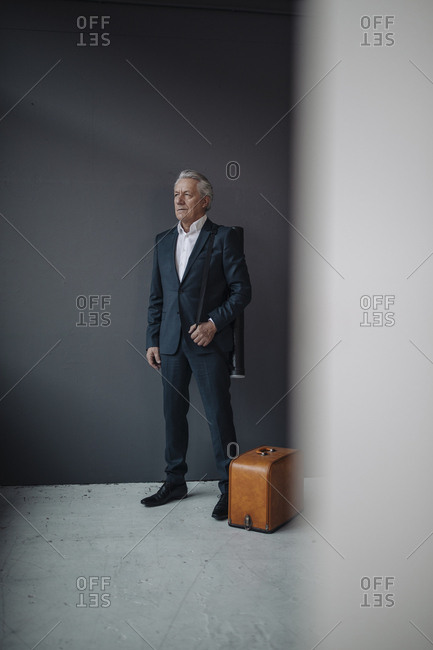 Senior businessman with old-fashioned suitcase