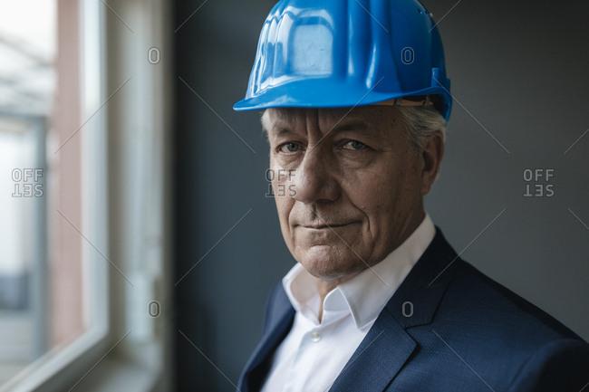 Portrait of a confident senior businessman wearing hard hat