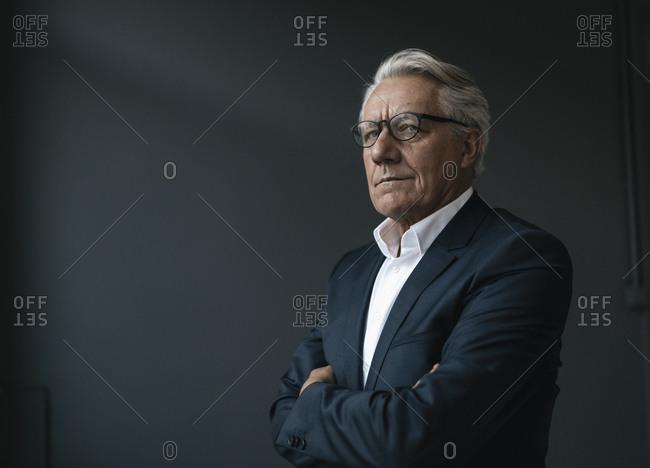 Portrait of a senior businessman looking away