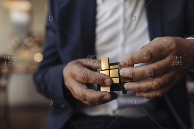 Close-up of businessman with Rubik's Cube