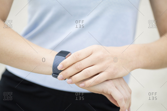 Close-up of woman checking her fitness tracker
