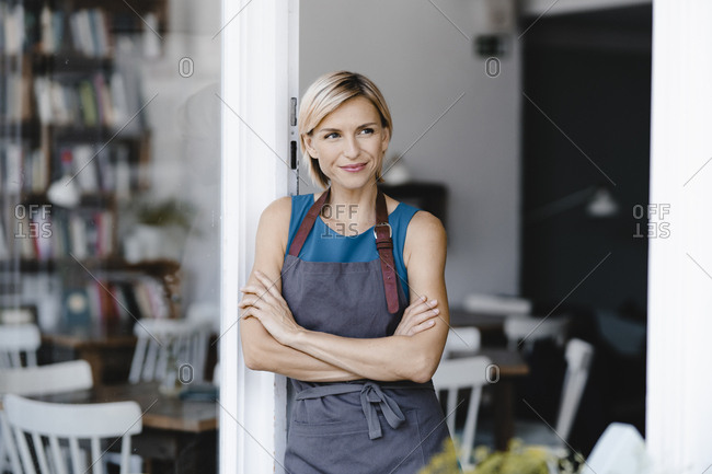 Business owner standing in front of her coffee shop