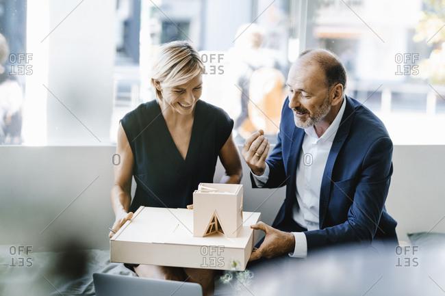 Architect explaining model to customer