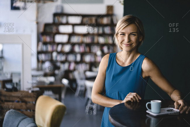 Business woman relaxing with a cup of coffee