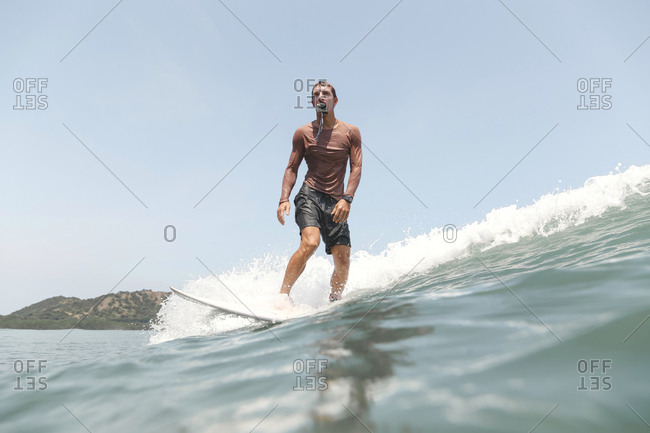 Surfer with action camera in the mouth