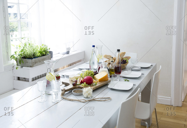 Laid table with fruit- cheese and bread
