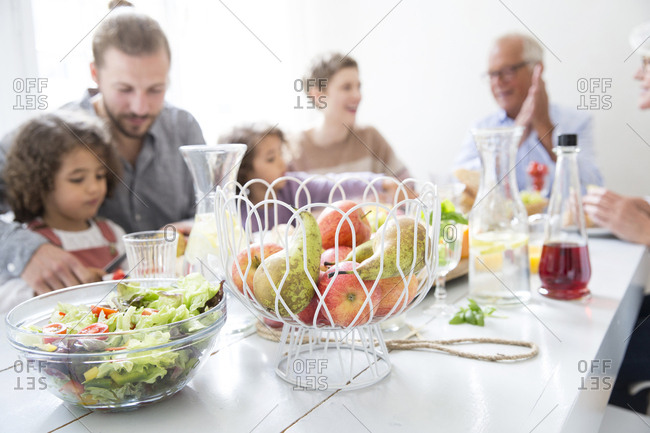 Extended family having healthy lunch at home