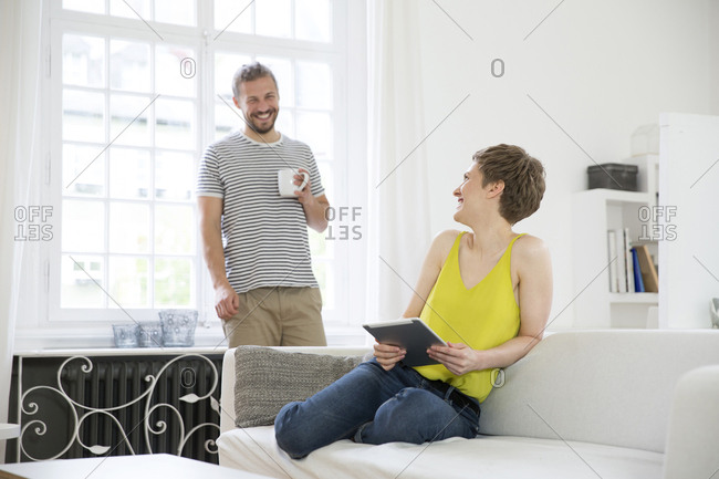 Happy young couple in living room at home