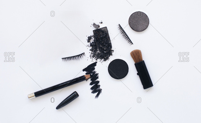 Black colored make up on a white background
